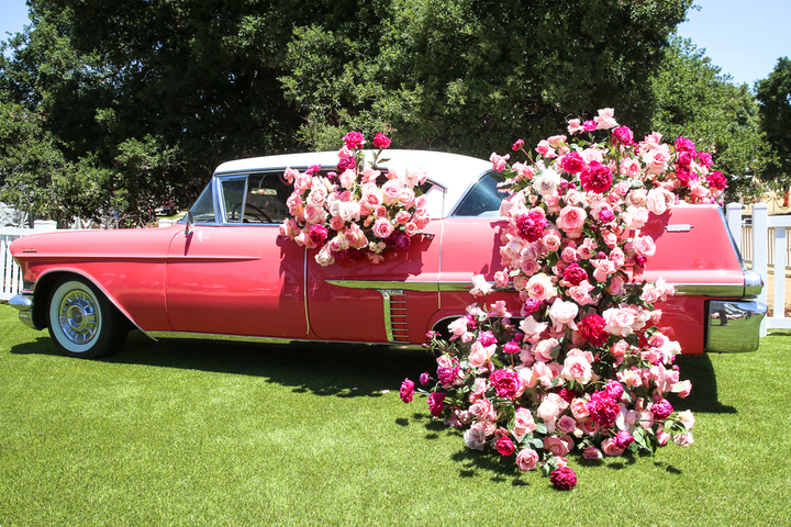 Rosé Day L.A. featured photo-friendly, over-the-top decor like a pink Cadillac covered with roses.