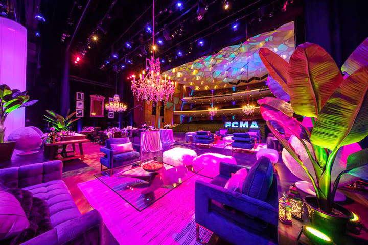 In early February, P.C.M.A. hosted a 'Think Tank' meeting on the stage of the Terrace Theater at the Long Beach Convention and Entertainment Center. The theater was transformed with ornate chandeliers, a mix of banquet tables and lounge seating, and colorful projection mapping.