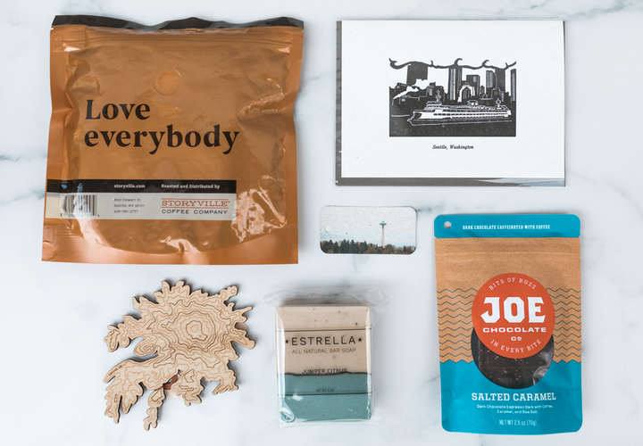 Keep Your City Smiling sells gift boxes that benefit struggling local businesses. The boxes include goods such as chocolate, art cards, craft coffee, candles, mugs, and lotions.