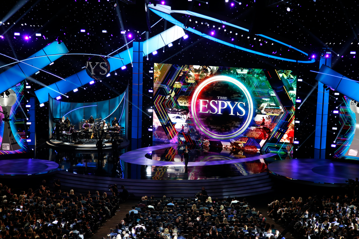 The 2020 ESPY Awards are going virtual. The two-hour broadcast, which will celebrate heroism and humanitarian aid, will air June 21 on ESPN; athletes Russell Wilson, Megan Rapinoe, and Sue Bird will host from their homes. The star-studded sports event had long been held at L.A.'s Microsoft Theatre in July; last year's 5,000-attendee show (pictured) focused on sustainability, inclusivity, and—of course—the United States women's national soccer team, fresh off its World Cup win. See more from the 2019 show here.