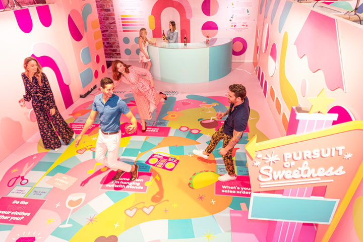 At the Rosé Mansion, guests can follow a colorful floor flowchart—reminiscent of a Candy Land board game—to discover their preferences for sweet or bitter flavors. Currently, organizers are hosting digital events like virtual happy hours via Instagram while the space is shut down.