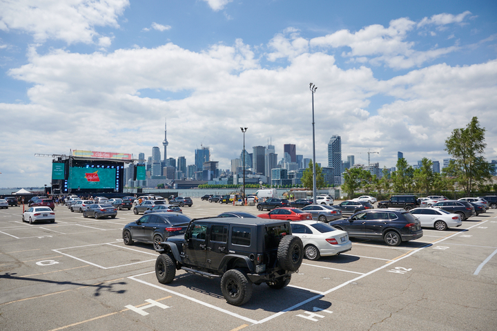 Toronto's CityView Drive-In Theatre—which takes over the parking lot for Rebel nightclub—opens tonight with a concert by Hamilton-area band Monster Truck. The venue houses about 200 vehicles in parking spots at least seven feet apart, all with views of a 238-foot stage with three LED screens. Future concerts will include Allan Rayman on July 18 and A Tribe Called Red on Aug. 6. The drive-in is being managed by INK Entertainment.