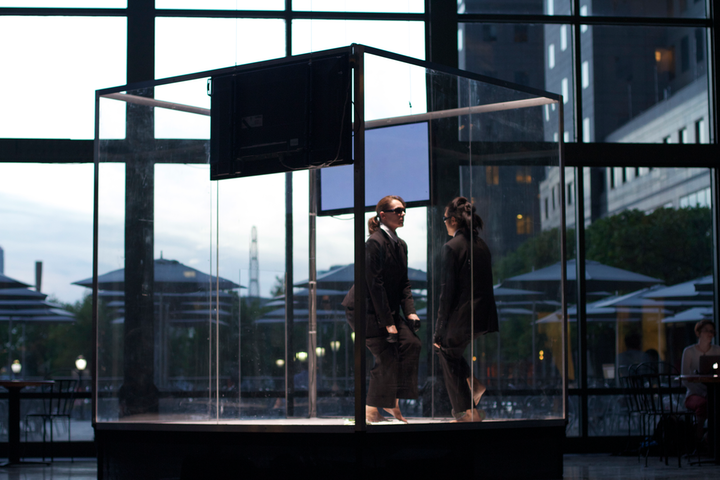 Originally staged at Brookfield Place in downtown Manhattan, The Attendants featured two performers confined in a giant Plexiglass cube.