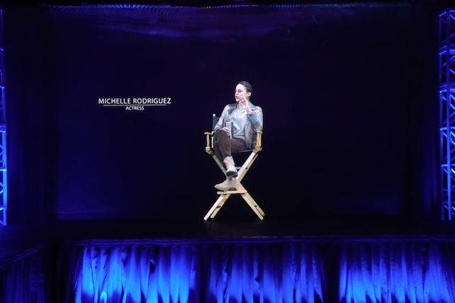ARHT Media Inc.'s interactive Holographic TelePresence (shown here) telecasts speakers into an event, just as if a person is really there.