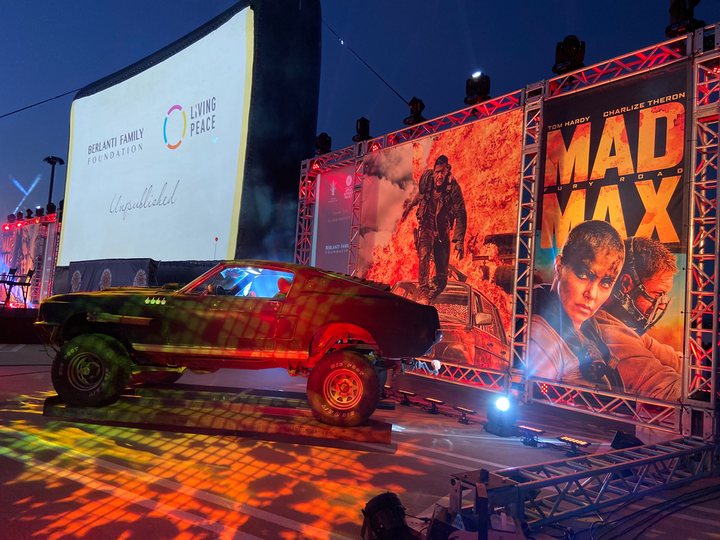 The July 31 fundraiser, which benefited the Charlize Theron Africa Outreach Project, drew roughly 90 cars for a live stunt show, Q&A, silent auction, and screening of Mad Max: Fury Road.