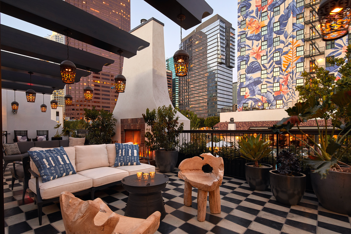 """The 100-year-old Hotel Figueroa in Los Angeles has launched a new micro-wedding package starting at $149 per person. The events can host as many as 25 people, with add-ons such as small bites at the 1,500-square-foot Rick's space (pictured), audiovisual packages for a virtual component, a photo booth, and more. """"We are offering the same elevated experience as a larger wedding, simply on a smaller, more socially distanced scale. This creates an overall atmosphere that is relaxed and is a joyful celebration while still prioritizing safety,"""" says Matt Vargas, the hotel's director of sales and marketing."""